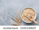 rolled oats  oat flakes in bowl ... | Shutterstock . vector #1335130829