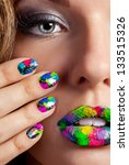 Small photo of Half face of attractive girl with beautiful multicolor holographic Minx nails and bright colorful make-up