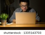 asian business man working at... | Shutterstock . vector #1335163703