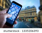 close up of tourist using gps... | Shutterstock . vector #1335206393