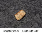 tigers eye gemstone isolated on ... | Shutterstock . vector #1335335039