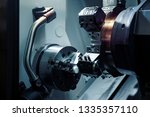cnc machine tool in metal... | Shutterstock . vector #1335357110