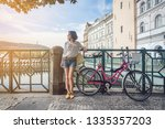 attractive girl with bike in... | Shutterstock . vector #1335357203