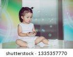little baby girl playing... | Shutterstock . vector #1335357770