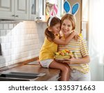 happy easter  family mother and ... | Shutterstock . vector #1335371663
