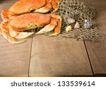 Two Dungeness Crabs And Net...