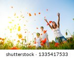 family in red poppy field | Shutterstock . vector #1335417533