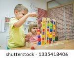 caucasian children in pre school | Shutterstock . vector #1335418406