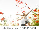 mother and son stand in poppy... | Shutterstock . vector #1335418433