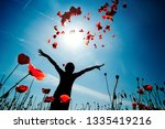 girl stands in poppy field | Shutterstock . vector #1335419216