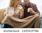 happy couple eating sandwiches... | Shutterstock . vector #1335419786