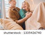selective focus of happy couple ... | Shutterstock . vector #1335426740