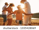 happy family embracing together ... | Shutterstock . vector #1335428069