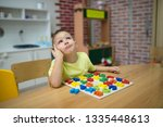 little boy and educational toy | Shutterstock . vector #1335448613
