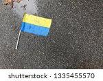 yellow blue ukrainian flag lies ... | Shutterstock . vector #1335455570