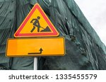 an orange sign with arrow... | Shutterstock . vector #1335455579