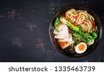 miso ramen asian noodles with... | Shutterstock . vector #1335463739