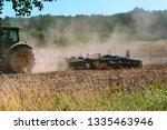 tractor plowing in the field ... | Shutterstock . vector #1335463946