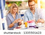 busy employed couple  happy... | Shutterstock . vector #1335501623