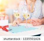 close up of hand with wine... | Shutterstock . vector #1335501626