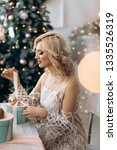 charming blonde woman opens... | Shutterstock . vector #1335526319
