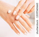 young female hands with... | Shutterstock . vector #1335560660