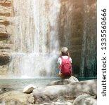 female backpacker explorer... | Shutterstock . vector #1335560666