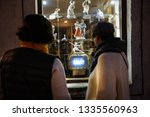 two women watching old soviet... | Shutterstock . vector #1335560963