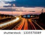 speed traffic at sundown  ... | Shutterstock . vector #1335570089