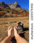 feet of a hiker relaxing in the ... | Shutterstock . vector #1335575450