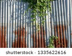 galvanized fence has been used... | Shutterstock . vector #1335622616