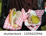 Stock photo traditional dutch food herring fish with onion cucumber and holland flag in fastfood market of 1335622946