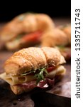 classic croissant sandwiches on ... | Shutterstock . vector #1335711743