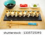 variation of sushi and rolls on ... | Shutterstock . vector #1335725393
