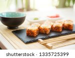 sushi rolls with salmon and hot ... | Shutterstock . vector #1335725399