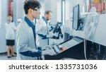 on high tech factory asian... | Shutterstock . vector #1335731036