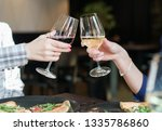 friends toasting  saying cheers ... | Shutterstock . vector #1335786860
