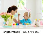 mother and kids color easter...   Shutterstock . vector #1335791153