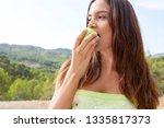 portrait of beautiful young... | Shutterstock . vector #1335817373