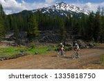 Mountain Bikers Riding Along A...