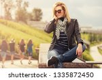 happy young fashion blonde...   Shutterstock . vector #1335872450