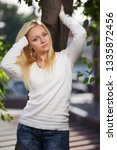 young fashion blond woman in...   Shutterstock . vector #1335872456