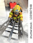 Firefighter Ascends Upon A One...