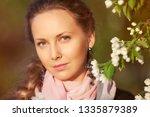 happy beautiful woman in a...   Shutterstock . vector #1335879389