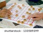 Hands Of Senior Men Playing...