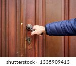 the man opens the closed old...   Shutterstock . vector #1335909413