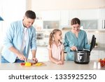 happy family preparing food... | Shutterstock . vector #1335925250