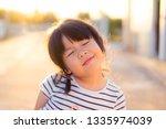 blind little girl.little girl... | Shutterstock . vector #1335974039