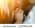woman praying on holy bible in... | Shutterstock . vector #1335982166