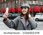 woman with smartphone take... | Shutterstock . vector #1336002149